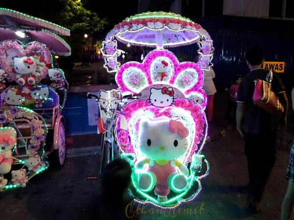 Colourful, flashy Hello Kitty trike in Melaka